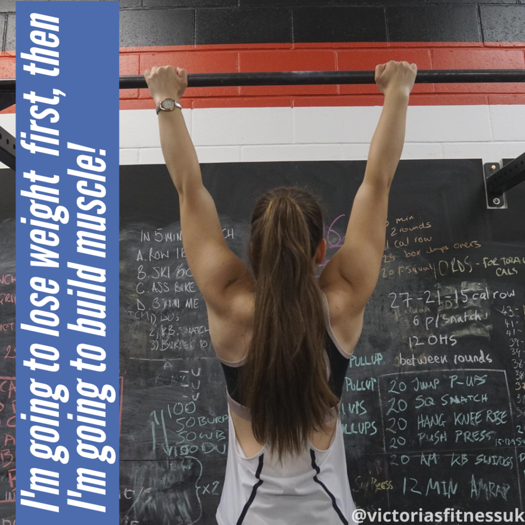 back of fit girl hanging off pullup bar